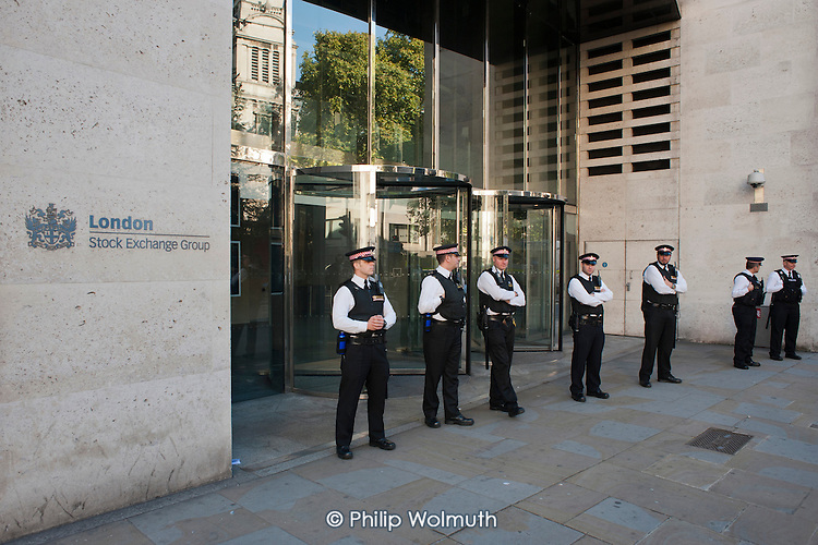 Police guard the Stock Exchange. Occupy the London Stock Exchange. Protesters gather at St.Pauls Cathedral on a global day of action against corporate greed.