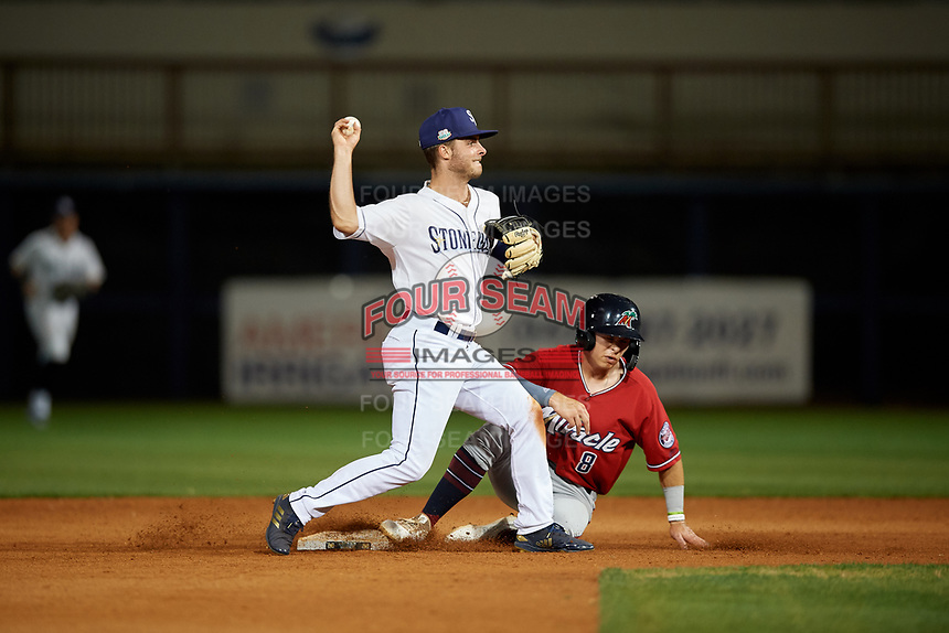 Charlotte Stone Crabs shortstop Tyler Frank (5) throws to first as Michael Helman (8) slides into second base during a Florida State League game against the Fort Myers Miracle on April 6, 2019 at Charlotte Sports Park in Port Charlotte, Florida.  Fort Myers defeated Charlotte 7-4.  (Mike Janes/Four Seam Images)