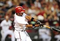 Jul. 29, 2009; Phoenix, AZ, USA; Arizona Diamondbacks outfielder Justin Upton hits a two run home run in the first inning against the Philadelphia Phillies at Chase Field. Mandatory Credit: Mark J. Rebilas-