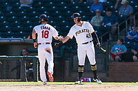 Surprise Saguaros first baseman Will Craig (45), of the Pittsburgh Pirates organization, congratulates Tommy Edman (18) during an Arizona Fall League game against the Peoria Javelinas at Surprise Stadium on October 17, 2018 in Surprise, Arizona. (Zachary Lucy/Four Seam Images)