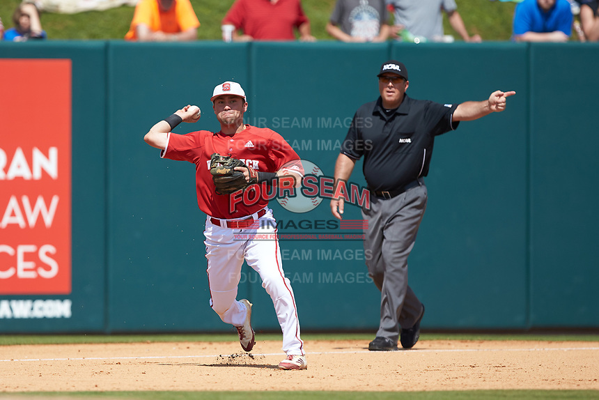 North Carolina State Wolfpack third baseman Stephen Pitarra (7) makes a throw to first base as third base umpire Eric Loveless signals fair ball during the game against the Army Black Knights at Doak Field at Dail Park on June 3, 2018 in Raleigh, North Carolina. The Wolfpack defeated the Black Knights 11-1. (Brian Westerholt/Four Seam Images)