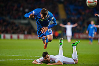 Wednesday 05 March 2014<br /> Pictured:Theodor Elmar Bjarnason of Iceland fly's over the top of Neil Taylor <br /> Re: International friendly Wales v Iceland at the Cardiff City Stadium, Cardiff,Wales UK