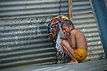 Indian boy takes a bath in Allahabad during Kumbh Mela Festival.