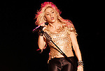 Shakira performs on her tour The Sun Comes Out