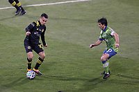 COLUMBUS, OH - DECEMBER 12: Lucas Zelarayan #10 of the Columbus Crew is defended by Nicolas Lodeiro #10 of the Seattle Sounders FC during a game between Seattle Sounders FC and Columbus Crew at MAPFRE Stadium on December 12, 2020 in Columbus, Ohio.