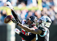 CHARLOTTE, NC - NOVEMBER 17: Isaiah Oliver #26 of the Atlanta Falcons defends against D.J. Moore #12 of the Carolina Panthers during a game between Atlanta Falcons and Carolina Panthers at Bank of America Stadium on November 17, 2019 in Charlotte, North Carolina.