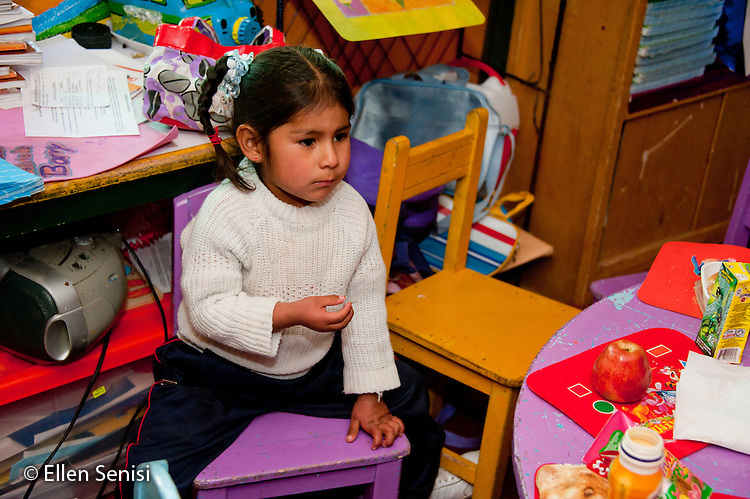 Arequipa, Peru. I.E.P. Sagrados Corazones de Jesus y Maria, a parochial (Christian), private early childhood education school. Student (girl, pre-school age, Peruvian) in primary school classroom. No MR. ID: AL-peru.
