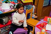 Arequipa, Peru. I.E.P. Sagrados Corazones de Jesus y Maria, a parochial (Christian), private early childhood education school. Student (girl, pre-school age, Peruvian) in primary school classroom. No MR. ID: AL-peru.