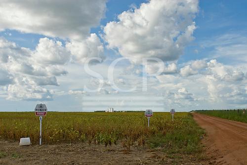Mato Grosso, Brazil. Fazenda Tanguro, Govenor Blairo Maggi's soya farm. The land was forested unttil a few years ago. Silo and signs.
