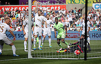 Kelechi Iheanacho of Manchester City (in green) watches on as his shot ends in the nets making the score 0-1 during the Swansea City FC v Manchester City Premier League game at the Liberty Stadium, Swansea, Wales, UK, Sunday 15 May 2016