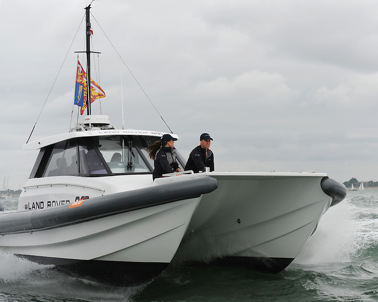The Duke and Duchess of Cambridge watch the racing form the Land Rover BAR support boat during day two of the Louis Vuitton America's Cup World Series racing, Portsmouth, United Kingdom. (Photo by Rob Munro/Stewart Communications)
