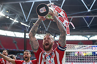 Pontus Jansson of Brentford celebrates at full time with the trophy for the the Sky Bet Championship Play Off Final match between Brentford and Swansea City at Wembley Stadium in London, England, UK. Saturday 29 May 2021