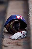 A Team USA cap rests on top of a glove on the dugout steps at Knights Stadium July 16, 2010, in Fort Mill, South Carolina.  Photo by Brian Westerholt / Four Seam Images