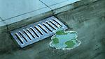 Illustrative image of liquid near drain representing natural resource wastage