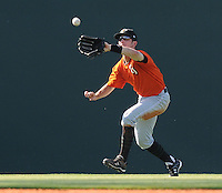 Left fielder Nick Liles (10) of the Augusta GreenJackets picks off a fly ball in a game against the Greenville Drive on May 23, 2010, at Fluor Field at the West End in Greenville, S.C. Photo by: Tom Priddy/Four Seam Images