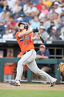 Auburn Tigers designated hitter Connor Davis (24) follows through on his swing during Game 4 of the NCAA College World Series against the Mississippi State Bulldogs on June 16, 2019 at TD Ameritrade Park in Omaha, Nebraska. Mississippi State defeated Auburn 5-4. (Andrew Woolley/Four Seam Images)