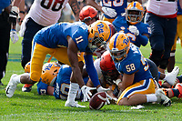 Pitt defensive back Dane Jackson (11) recovers a fumble and returns it 35 yards for a touchdown. Also pictured is Pitt linebacker Quintin Wirginis (58) who caused the fumble. The Pitt Panthers defeated the Syracuse Orange 44-37 in overtime at Heinz Field in Pittsburgh, Pennsylvania on October 6, 2018.