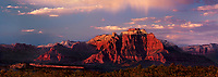 999400002  panoramic view -  a clearing summer storm produces large cloud formations over west temple and the zion national park formations all bathed in evening light and seen from a backcountry road east of hurricane utah