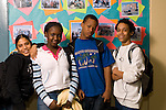 High school male and female students posing in corridor