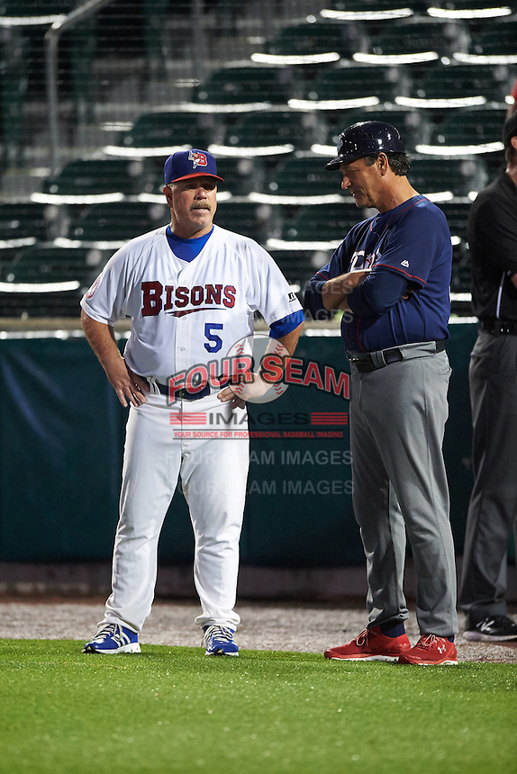 Buffalo Bisons manager Gary Allenson (5) talks with Sal Rende (25) during a rain delay against the Lehigh Valley IronPigs on July 9, 2016 at Coca-Cola Field in Buffalo, New York.  Lehigh Valley defeated Buffalo 9-1 in a rain shortened game.  (Mike Janes/Four Seam Images)