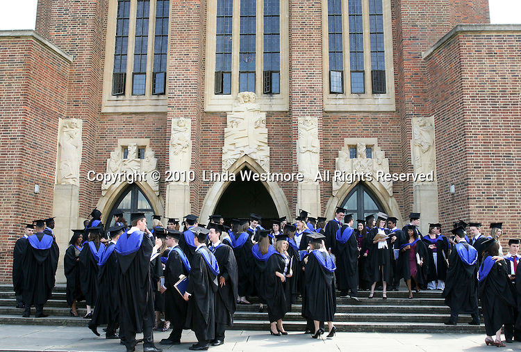 Happy graduates outside Guildford cathedral, University of Surrey.