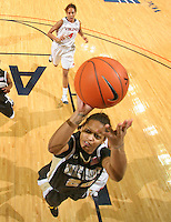 Feb. 3, 2011; Charlottesville, VA, USA; Wake Forest Demon Deacons forward Brittany Waters (20) shoots in front of Virginia Cavaliers center Simone Egwu (4) during the game at the John Paul Jones Arena. Virginia won 73-46. Mandatory Credit: Andrew Shurtleff
