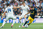 Yannick Ferreira Carrasco (r) of Atletico de Madrid competes for the ball with Toni Kroos (c) and Carlos Henrique Casemiro of Real Madrid during their 2016-17 UEFA Champions League Semifinals 1st leg match between Real Madrid and Atletico de Madrid at the Estadio Santiago Bernabeu on 02 May 2017 in Madrid, Spain. Photo by Diego Gonzalez Souto / Power Sport Images