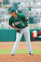Augusta GreenJackets relief pitcher Steven Okert (15) looks to his catcher for the sign against the Greensboro Grasshoppers at NewBridge Bank Park on August 11, 2013 in Greensboro, North Carolina.  The GreenJackets defeated the Grasshoppers 6-5 in game one of a double-header.  (Brian Westerholt/Four Seam Images)