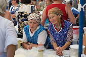 Peasant women sell cream cheese and other dairy produce at a market in Krakow.
