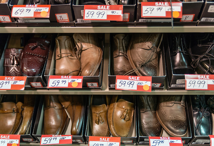 Men's shoes discounted in a store sale.