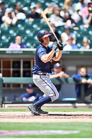 Gwinnett Braves left fielder Matt Tuiasosopo (5) swings at a pitch during a game against the Charlotte Knights at BB&T Ballpark on May 7, 2017 in Charlotte, North Carolina. The Knights defeated the Braves 7-1. (Tony Farlow/Four Seam Images)