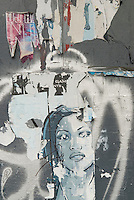 Street Art on the Lower East Side, Layers of Torn Street Art Posters and Graffiti  on Delancey Street, Lower Manhattan, New York City, New York State, USA