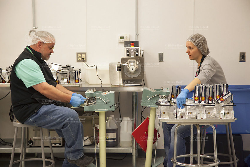 USA. Colorado state. Denver. Workers at Dixie. Established in 2010 as allowed by Colorado House Bill 1284 (cannabis liberalization), Dixie Elixirs and Edibles manufactures seven premium THC-infused product lines. As the leader in medical marijuana infused products, Dixie was proud to receive the first Infused Products Retail Marijuana License. Dixie Edibles™ (marijuana edibles) are handcrafted and created by our culinary professionals using the highest quality ingredients and sativa-dominant cannabis. From mouth-watering truffles and marijuana chocolate to refreshing mints, edible, thc-infused treats are perfect for any occasion. Cannabis, commonly known as marijuana, is a preparation of the Cannabis plant intended for use as a psychoactive drug and as medicine. Pharmacologically, the principal psychoactive constituent of cannabis is tetrahydrocannabinol (THC); it is one of 483 known compounds in the plant, including at least 84 other cannabinoids, such as cannabidiol (CBD), cannabinol (CBN), tetrahydrocannabivarin (THCV), and cannabigerol (CBG). 18.12.2014 © 2014 Didier Ruef