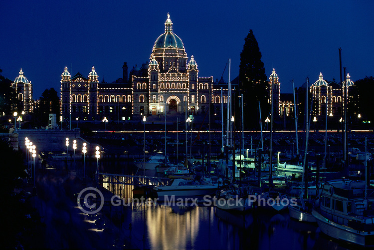 Victoria, BC, Vancouver Island, British Columbia, Canada - BC Parliament Buildings illuminated at Night along Inner Harbour