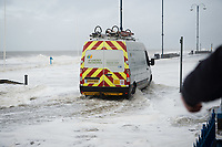 "Pictured: A van is caught up in water caused by waves that crash against the seaside town of Aberystwyth, Wales, UK. Saturday 21 October 2017<br /> Re: Coastal parts of the UK is facing winds of up to 70mph as Storm Brian causes roads to close and public transport to be cancelled.<br /> Roads in Aberystwyth's seafront and at nearby Aberaeron, Wales are shut on Saturday morning as a yellow ""be aware"" Met Office warning is in place.<br /> Seven flood warnings have been issued for the west Wales coast."