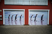 Germany. Mecklenburg-Vorpommer state. Zingst. Photo Festival. Horizonte Zingst Umweltfotofestival. Private house. Garage door. A picture by photographer Ingo Arndt about a group of King Penguins walking on beach at Volunteer Point in Falkland Islands. 31.05.19 © 2019 Didier Ruef