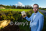 """Owen O'Shea with his book """"Ballymacandy"""" The Story of the Kerry Ambush at the site of the ambush on Monday evening."""