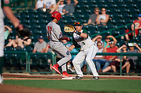 Fort Wayne TinCaps first baseman Luke Becker (9) waits for a pickoff attempt throw as Edwin Figuera (12) gets back to the bag during a Midwest League game against the Peoria Chiefs on July 17, 2019 at Parkview Field in Fort Wayne, Indiana.  Fort Wayne defeated Peoria 6-2.  (Mike Janes/Four Seam Images)