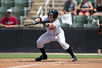 Casey Schroeder (17) of the Kannapolis Intimidators attempts to lay down a bunt against the West Virginia Power at Kannapolis Intimidators Stadium on June 18, 2017 in Kannapolis, North Carolina.  The Intimidators defeated the Power 5-3 to win the South Atlantic League Northern Division first half title.  It is the first trip to the playoffs for the Intimidators since 2009.  (Brian Westerholt/Four Seam Images)