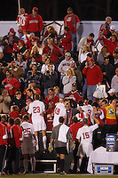 Ohio State Buckeyes players celebrate their victory over the University of Massachusetts Minutemen with fans at full time of an NCAA College Cup semi-final match at SAS Stadium in Cary, NC on December 14, 2007. Ohio State defeated Massachusetts 1-0.
