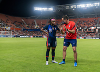 HOUSTON, TX - JUNE 13: Crystal Dunn #19 of the USWNT talks with Milan Ivanovic before a game between Jamaica and USWNT at BBVA Stadium on June 13, 2021 in Houston, Texas.