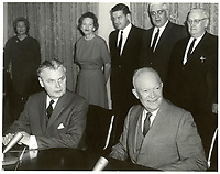 John Diefenbaker (seated left) and US President Dwight D. Eisenhower at the signing of the Columbia River Treaty, January 1961.