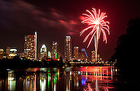 4th of July Fireworks Display paints Town Lake bright red in Austin, Texas