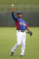 Josh Morgan #3 of the AZL Rangers warms up before a game against the AZL Cubs at Surprise Stadium on July 6, 2014 in Surprise, Arizona. (Larry Goren/Four Seam Images)