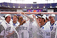 Devon Sherwood (1) of Duke cuts a piece of the net off the goal after the NCAA Men's Lacrosse Championship held at M&T Stadium in Baltimore, MD.  Duke defeated Notre Dame, 6-5, to win the title in overtime.