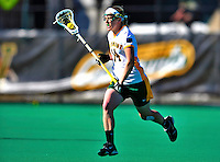 17 March 2010: University of Vermont Catamount midfielder Meg Johnson, a Senior from Olney, MD, in action against the Siena Saints at Moulton Winder Field in Burlington, Vermont. The Lady Cats fell to the visiting Saints 14-11. Mandatory Photo Credit: Ed Wolfstein Photo