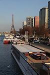 Modern high rise buildings on Left Bank of river Seine with Eiffel Tower La tour eiffel in the background. City of Paris. Paris. France