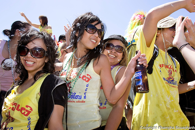 From left, Vikky Phommavong, Taylor Inthavong, and Moon Sengphalaya, along with hundreds participate in the parade celebrating the Lao New Year at Wat Lao Thepnimith in Fort Worth on April 25, 2010.  (photo by Khampha Bouaphanh)