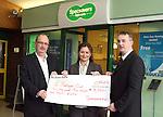 Specsavers present cheque to Bubblegum Club