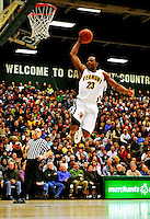 30 January 2010: University of Vermont Catamount forward Marqus Blakely, a Senior from Metuchen, NJ, jumps for a lay up during a game against the University at Albany Great Danes at Patrick Gymnasium in Burlington, Vermont. The Catamounts defeated the Danes 64-46 in the America East matchup. Mandatory Credit: Ed Wolfstein Photo